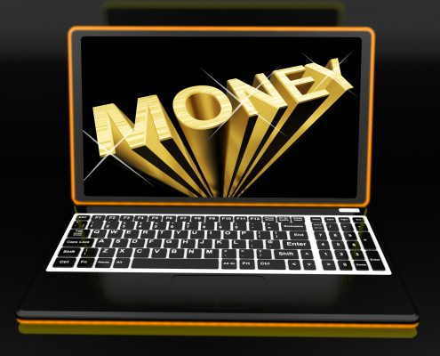 Money On Laptop Showing Earnings And Savings